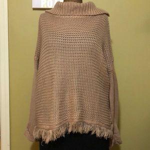 Knit sweater with fringe bottom